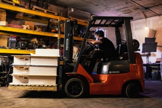 The sand-and-clay molds, weighing more than 200 pounds each, are carried from one point to the next on a forklift.